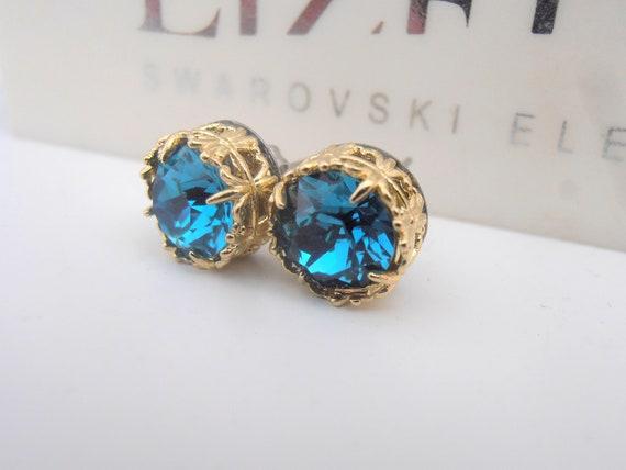 Golden stud earrings w/ Swarovski blue crystals