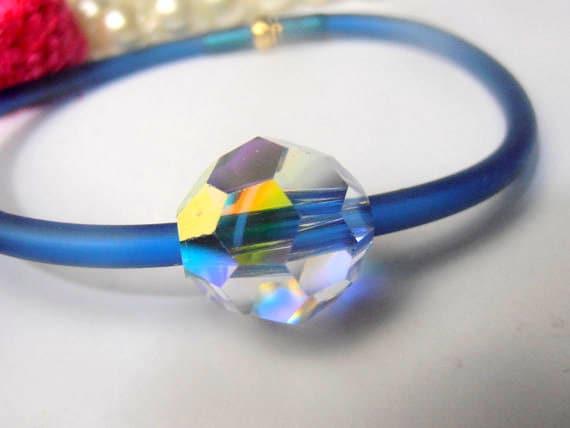 ONE, 12mm, Aurora Borealis, Swarovski Crystal Bracelet, Faceted Round Beads on a Metallic Blue Rubber Cord