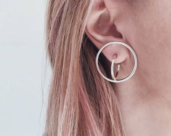 Impossible figure silver earrings