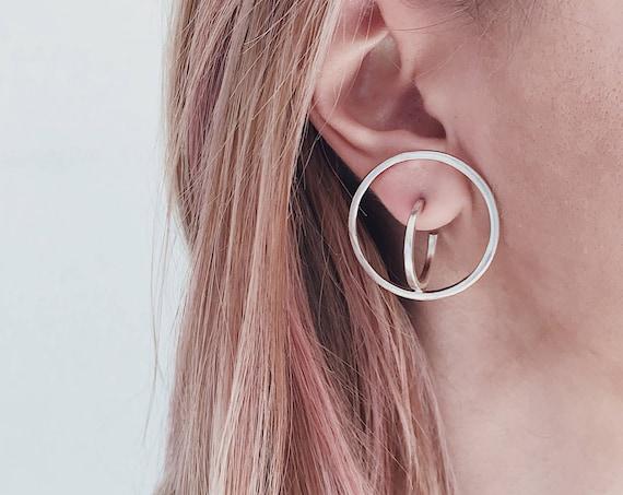 Impossible figure silver earrings