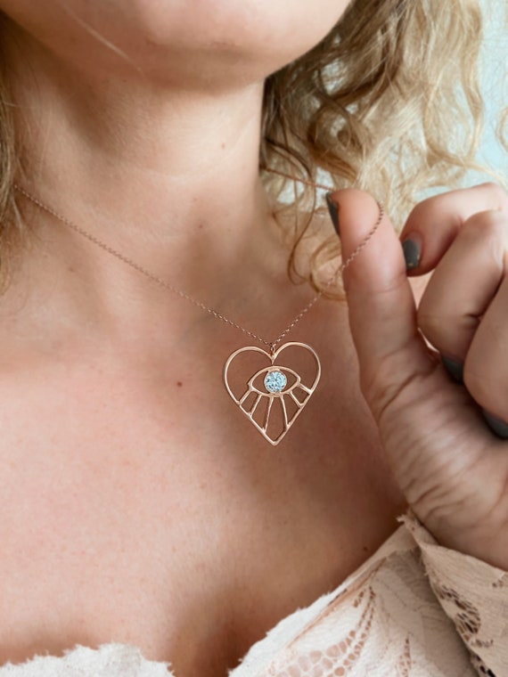 Rose gold heart and eye necklace with zircon