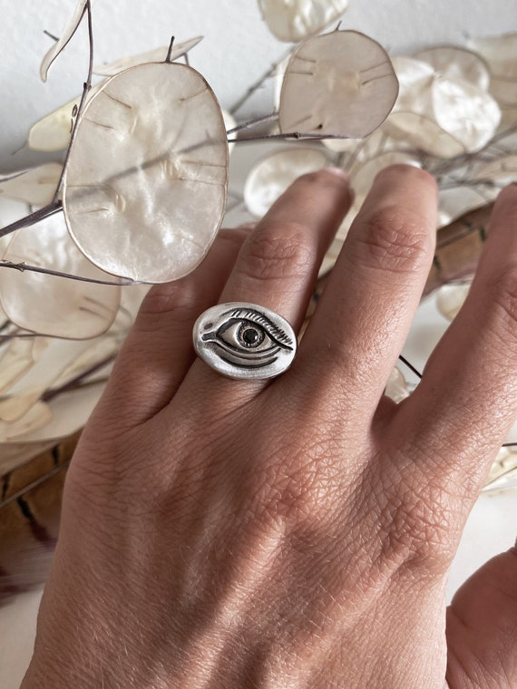 Silver eye ring with black zircon