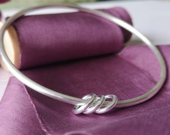 Handmade sterling silver bangle #threerings #northernireland #madetoorder #minimalist #contemporary #silverbangle #charms
