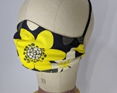 Sunny yellow flowers on black mask