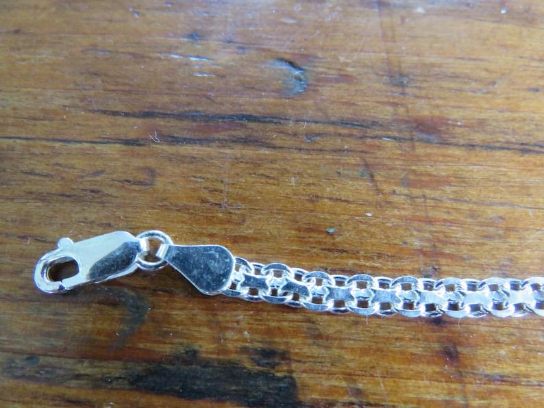Seven in 7 long flat chain link Italian FAS 925 sterling bracelet unusual and very pretty chain pattern 4.8 grams 925 sterling.