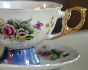 Tea Cup and Saucer, Iridescent White and Blue. Roses Violets.