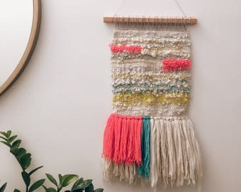 Woven wall hanging - Pink, blue, yellow, and cream woven wall hanging