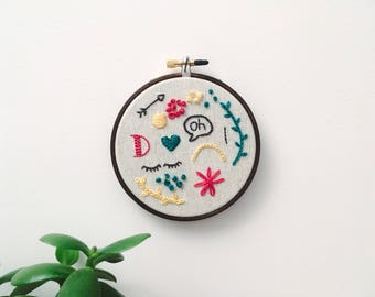 """Embroidery - Doodles hand embroidered 4"""" wall hanging (oh, D, arrow, eyes)"""