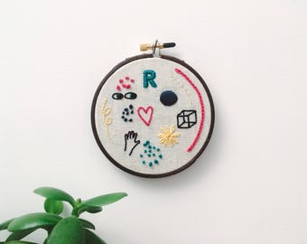 """Embroidery - Doodles hand embroidered 4"""" wall hanging (hand, cube, heart, R)"""