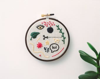 """Embroidery - Doodles hand embroidered 4"""" wall hanging (lol, scissors, leaf, eye)"""