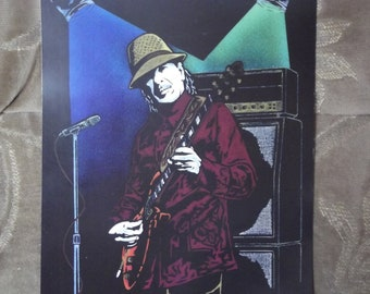 "Carlos Santana in Concert is a Limited Edition, 10""x13"", numbered Print of the Original Artwork by Artist Charles Freeman"