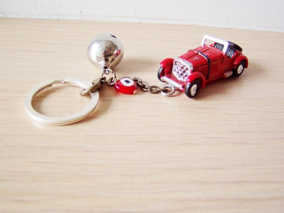 Antique car key chain with bell and eye in red or yellow