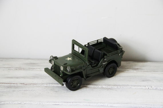 Green army jeep, retro army jeep miniature, collectible tin replica of army jeep, vintage classic jeep miniature