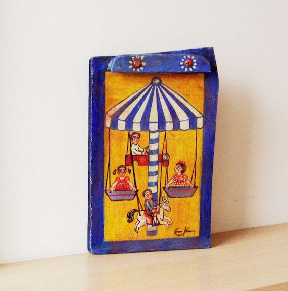 Vintage carousel folk painting, Greek folk art painting of children on a merry- go- round, retro ride, wooden painting from salvaged wood