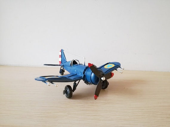 Blue metal plane, vintage, collectible miniature, retro plane with cockpit grid and moving propeller, royal blue airplane, retro aeroplane