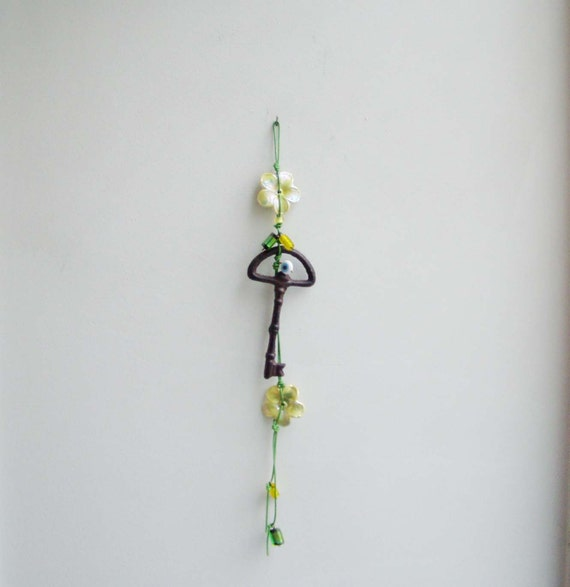 Key and flowers wall ornament, iron, skeleton key and ceramic flowers wall ornament with green cord and beads