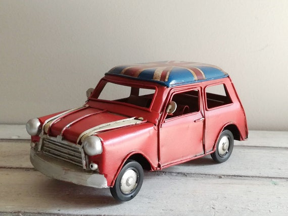 Red mini car miniature with British flag, vintage, collectible miniature, tin mini car replica with Union Jack rooftop, English car gift