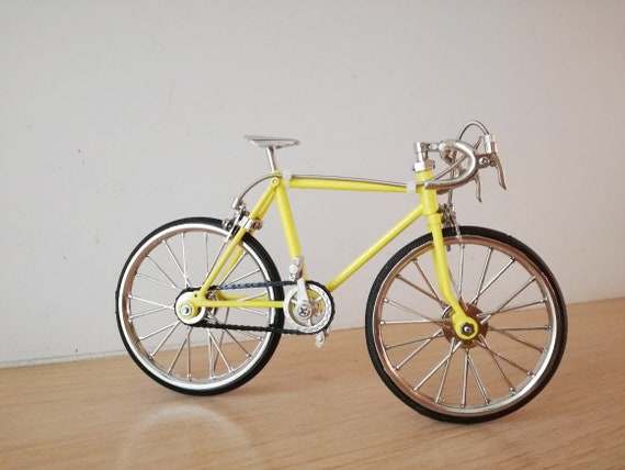 Yellow racing bike miniature, vintage collectible toy, yellow bicycle figurine, movable parts, retro racing bike replica in yellow