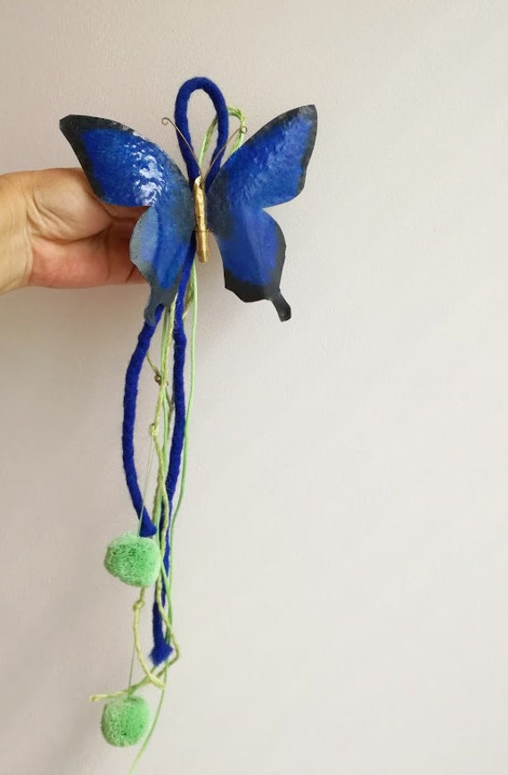 Blue butterfly wallhanging, brass cutout butterfly with with blue green ribbons and green pom pons, rustic, royal blue butterfly decor