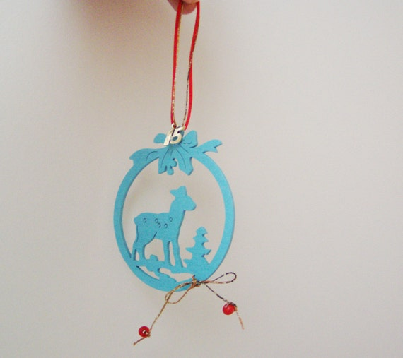 Turquoise blue ornament, light, wooden, Christmas ornament with deer, tree and holly outline, wood ornament with red cord