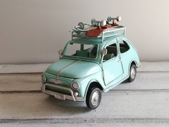 Blue car miniature with roller skates, retro collectible miniature, aqua blue Italian retro car with roller skates and skis on top