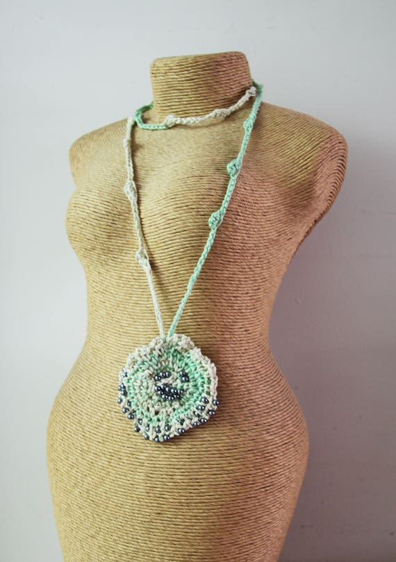 Green crochet pendant, minty green crocheted disk with embroidered, grey faux pearls, bohemian, crochet jewelry, mint white crochet necklace