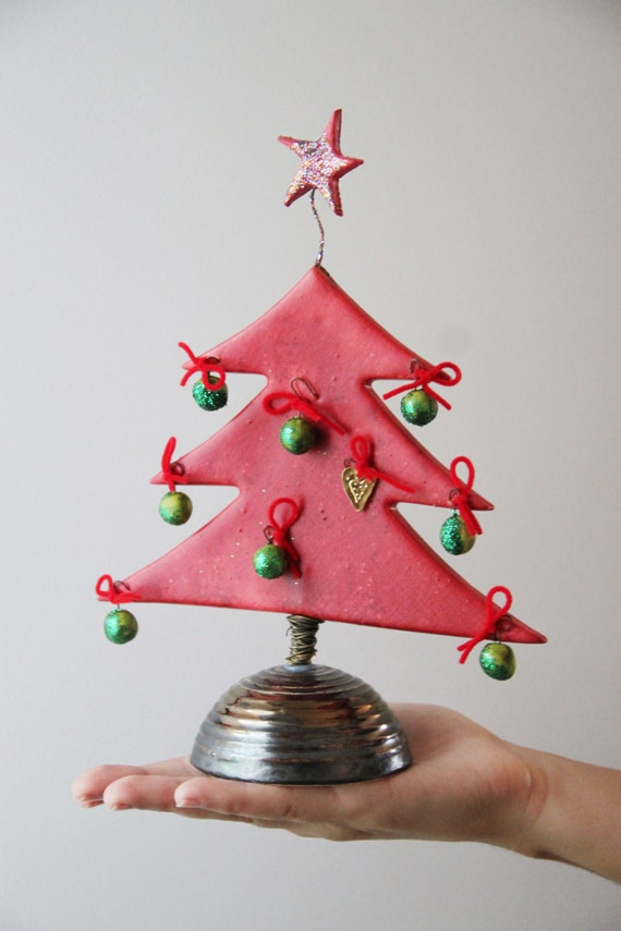 Red Chistmas tree sculpture, Xmas fir tree with green balls and sparkling star on top, ceramic, red Christmas tree miniature on brown base
