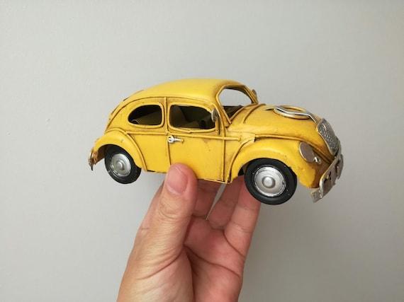 Yellow bug car miniature, collectible bug car miniature, shabby, retro buggy car in striking yellow, bug car replica, mid nineties
