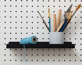 Small metal shelf for pegboard