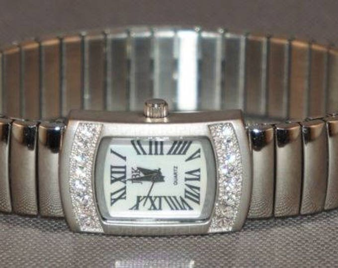 Jackie Kennedy Watch - Silver Stretch Band - Size 7.5