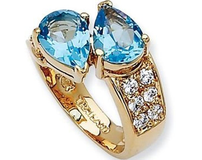 Jackie Kennedy Ring - Blue Topaz Bypass in Gold Plated Setting with Certificate