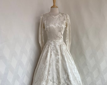 66857bdb4001 Vintage 1950s Ivory Floral Brocade Wedding Dress with Queen Anne Neckline,  Button Back, and Full Train