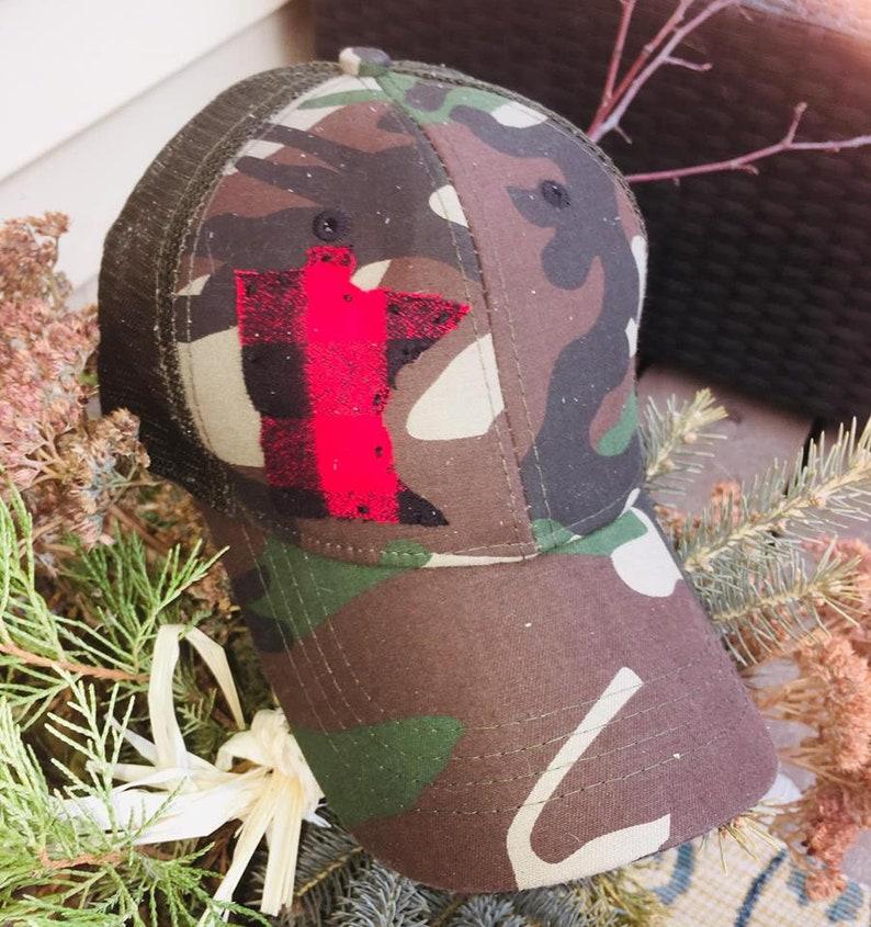 0647ddd37 Hat { Any state } Minnesota shown. Red/black buffalo plaid. Pony tail hat.
