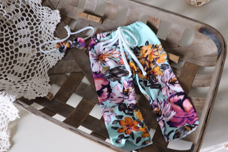 newborn pant  aqua with wildflower floral pant and knotted image 0