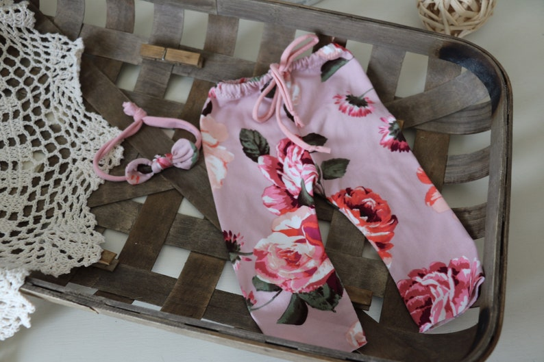 newborn pant  light pink peach and rose floral pant and image 0