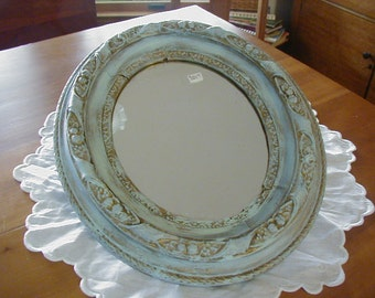 Wonderful Shabby Chic mirror would blend with any color palette.  13 x 15 inches and ready to hang, or use for centerpiece for candles.