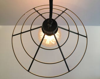 Modern cage light, metal industrial cage pendant light, minimal hanging light, black fabric covered cord.