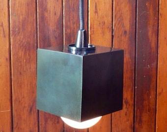 Modern lighting, minimal lighting, black cube pendant light, hanging light, bar lighting.