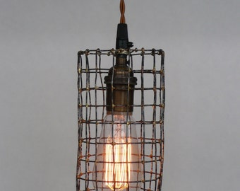 Handmade industrial lighting, steel and brass cage pendant light, with antique brass socket, Edsion bulb and cotton covered wire.