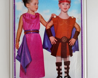 hercules goddess ancient greek or roman soldier costume sewing pattern butterick 2109 size 2 3 4 5 6 6x tunic cape leg bands dress