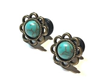"Blue turquoise flower plugs gauges: 14g 12g 10g  8g 6g 4mm 4g 5mm 2g 6mm 1g 7mm 0g 8mm 11/32"" 9mm 00g 10mm 7/16"" 11mm"
