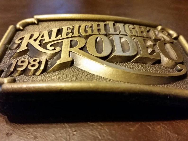 Cowboy buckle, Rodeo buckle brass buckle Raleigh Lights Rodeo belt buckle 80s
