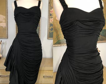 1960s Curvaceous Little Black Dress by Marie Norman Boutique -- Curve Hugging Silhouette with Dramatic Hip Swag!