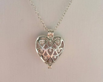 Heart locket with pink sea glass necklace
