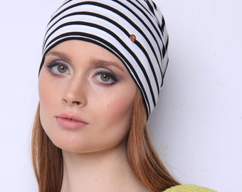 Hat - That's the essential that will catch everyone's eyes because of its expressive pattern