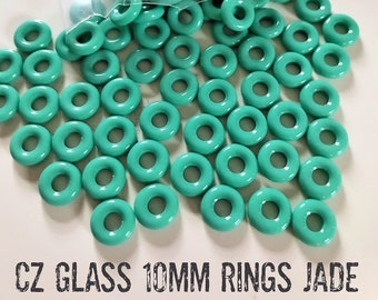 "NEW! JADE Czech GLASS Rings Donuts 10mm, large hole, 25 pieces, clear 3"" hanging tube"
