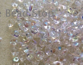 "CRYSTAL AB SuperUno one hole beads-2.5x5mm, 10 grams approx, 2"" in hanging tube for convient storage"