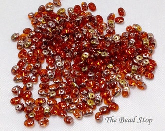 Superduos, Hyacinth Orange Capri Gold Crystal beads, 2.5 x 5mm, 10 grams (approx 110 beads), hanging 2 inch tube