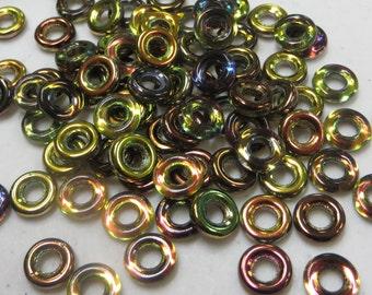 MAGIC GREEN Czech Glass Rings Donuts 9mm, 25 pcs, 3 inch hanging tube
