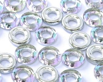 "Crystal Vitral Light Czech Glass Rings Donuts 9mm, light purple/blue tint, 25 pcs, clear 3"" plastic hanging tube"